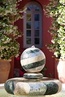 A fountain in the garden at Casa Mosaica