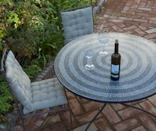 enjoy a glass of wine in the garden at Casa Mosaica