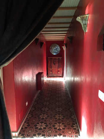 Lucilla mirror in red corridor